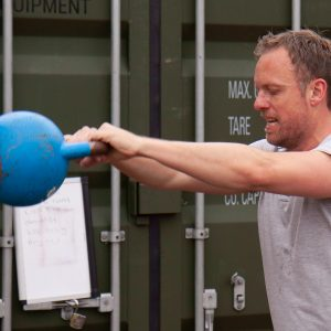 guy trains with kettlebell in personal training