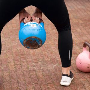 girl with kettlebell during proefles